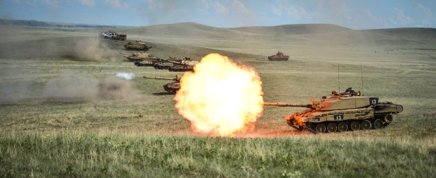 A line of Challenger 2's fire as part of the Royal Welsh Battle Group during Exercise Prairie Lightning.